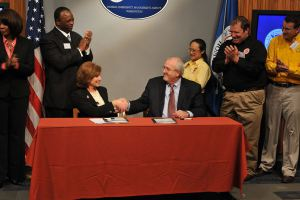FEMA Administrator W. Craig Fugate shakes hands with American Red Cross President and CEO Gail J. McGovern after the Memorandum of Agreement signing ceremony at FEMA headquarters.